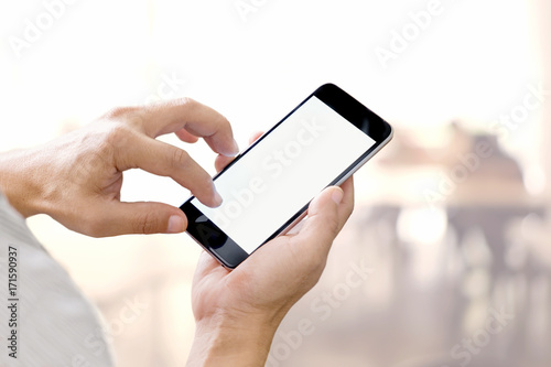 Fototapety, obrazy: Man hands holding blank screen smartphone with blurred background.