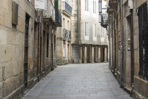 Poster Smal steegje One of the streets with stone houses inside the historic center of the city of Pontevedra (Spain)