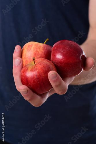 Fotografia, Obraz  Apples trio on Tshirt background. Apples in bright juicy color