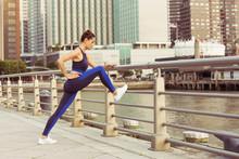 Woman Exercising On Railing At...