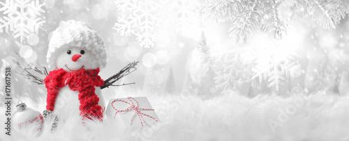 Obraz na plátně Snowman in winter setting