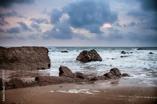Sunset over Rocks at Widemouth Bay, Cornwall Canvas Print