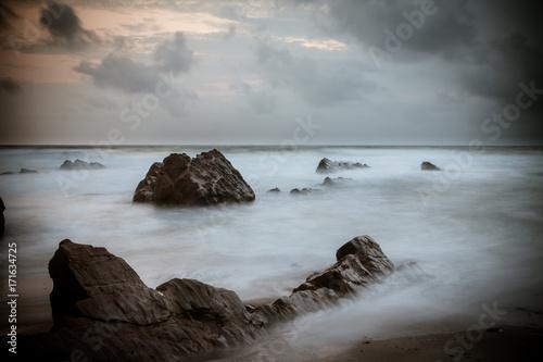 Photo Sunset over Rocks at Widemouth Bay, Cornwall