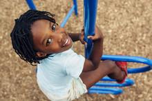 African American Child Climbin...