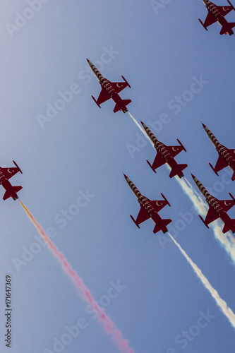Fotografering  The turkish acrobatic aviation squadron is flying over Izmir (Turkey) celebrating the 9th september day
