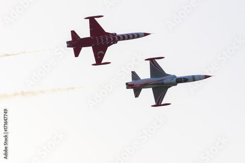 Turkish acrobatic aviation squadron is performing in the sky. Canvas Print