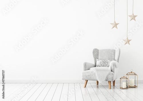 Christmas livingroom interior with velvet armchair, pillow, stars and lanterns on white wall background Fototapeta