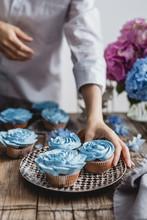 Woman Is Taking Blue Cupcake