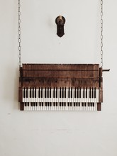 Old Piano Hanging From Chains ...