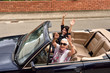 women of different generations happy in a convertible car