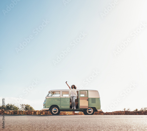 African woman having fun on road trip