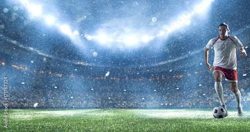Fotomural  Soccer player kicks the ball on the soccer stadium
