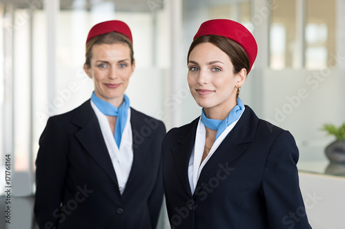 Smiling hostess at airport Canvas Print