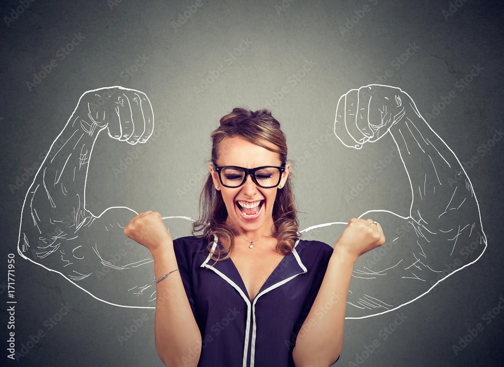 Fototapeta happy woman exults pumping fists celebrates success