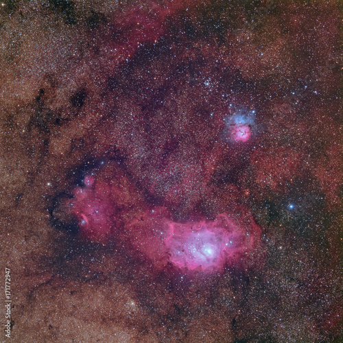 Beautiful nebulae in rich Milky way star field in the constellation Sagittarius including M8 the Lagoon nebula, M20 the Triffid nebula and NGC 6559
