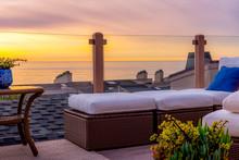 Ocean Sunset Over A Rooftop