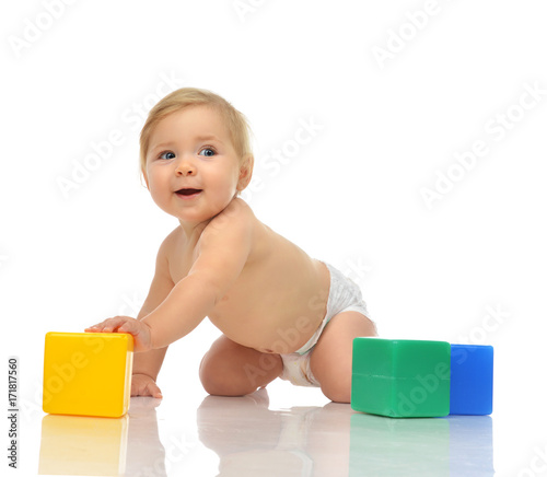 d0411985e Infant child baby boy toddler playing holding green blue yellow bricks in
