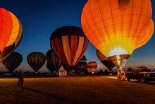 Hot Air Balloons Glowing In Ni...