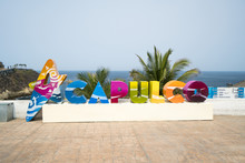 Colorful Acapulco Inscription Sign With Bright Colorful Letters On A Shoreline In Summer Sunny Day