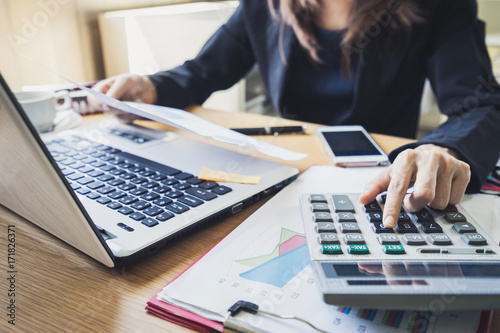 Businessman working on Desk office business financial accounting calculate Canvas Print