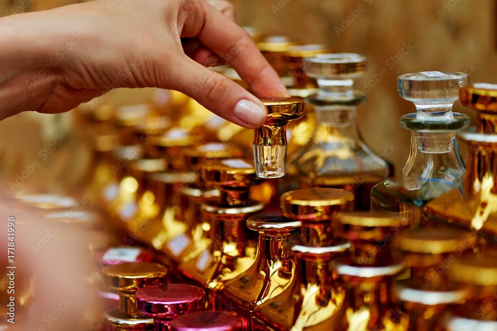 Fototapety, obrazy: Glass perfume bottles based oils. A Bazaar, market. Macro. Gold and pink gamma