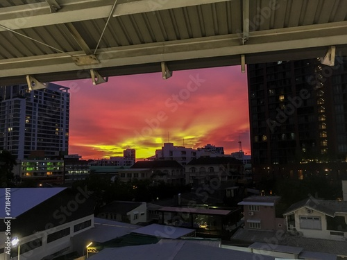 Fototapeta  red sky twilight during sunset view from ari BTS station