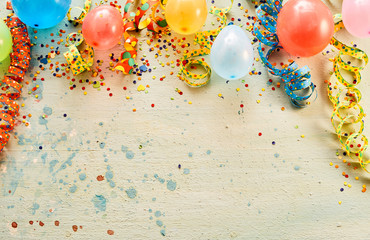 Balloons, confetti, ribbons with copy space