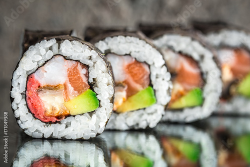 Poster Sushi bar Sushi roll with salmon, shrimps and avocado