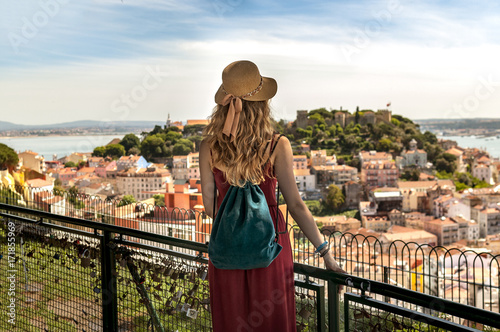 People in Lisbon - traveler on tour on city streets with panorama view