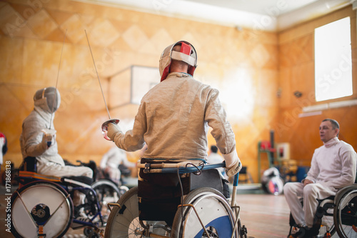 Tableau sur Toile training disabled fencers sitting on a wheelchair