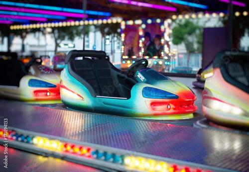 Poster Amusementspark Colorful electric bumper car in amusement park.