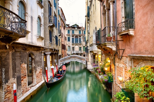 Tuinposter Venetie Traditional canal street with gondola in Venice, Italy