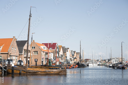 Photo  Sail boats and motor boats docked in a harbor in the historic fishing village of