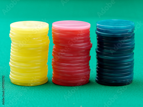 Poker colored Chips on green table Wallpaper Mural