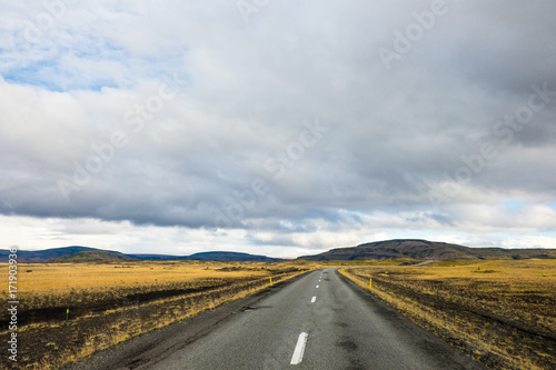 In de dag Route 66 Empty road leading to mountains, Iceland
