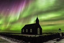 Magic Light Above The Black Wooden Church Of Budoir, Iceland