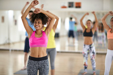 Girl On Group Cardio Training In Fitness Center
