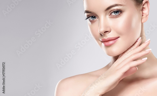 Fotografie, Obraz  Beautiful Young Woman with Clean Fresh Skin