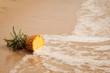 ripe yellow pineapple of a sandy beach