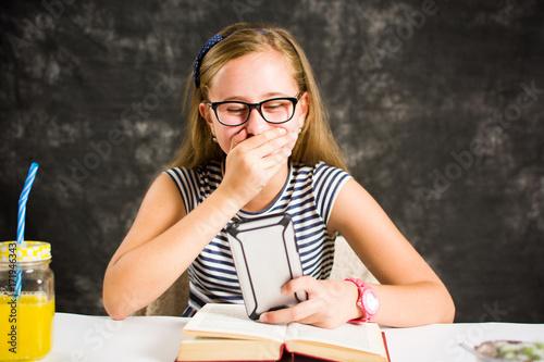 Fotografie, Obraz  Happy teen girl reading a text