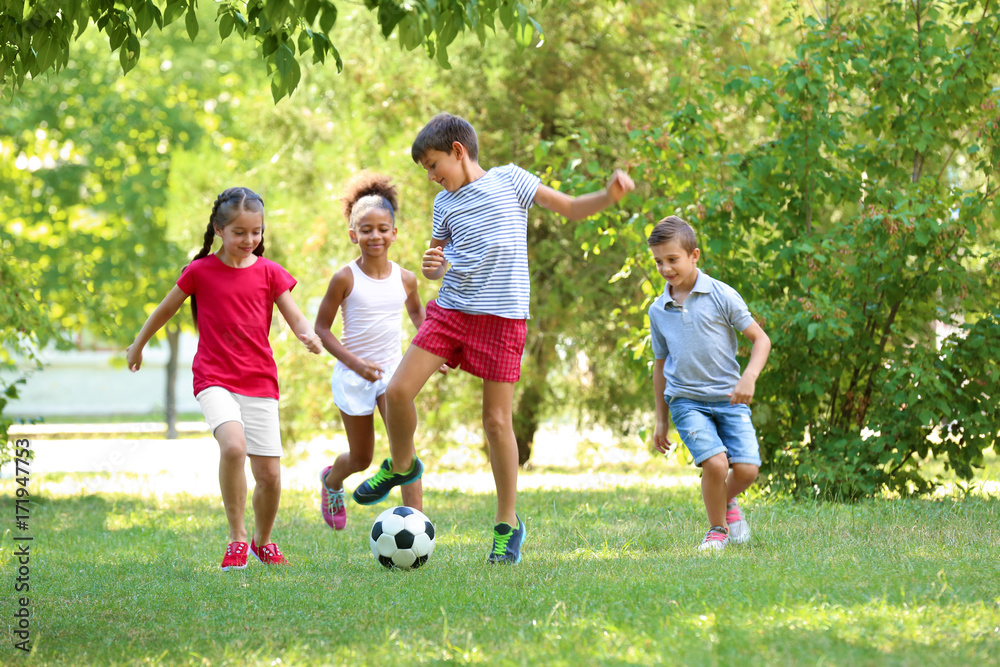Fototapety, obrazy: Cute children playing football in park
