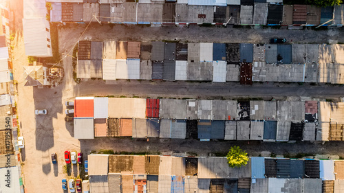 Fotografering  Dilapidated old shack looking one story buildings sitting in shade, depressed ar