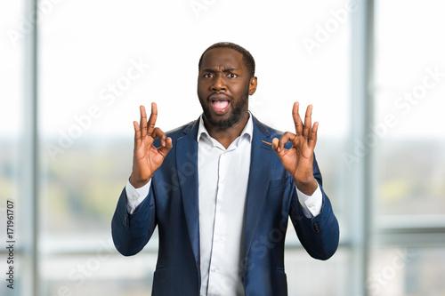 Black businessman gesturing OK Wallpaper Mural