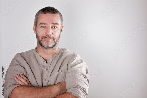 seirous mature middle aged man looking into camera
