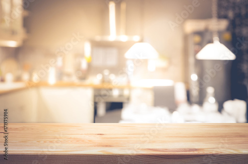 Foto Empty of wood table top on light abstract from kitchen room background