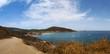 Corsica, 28/08/2017: la strada sterrata che porta alla spiaggia di Tamarone, una delle più famose e selvagge del Cap Corse, circondata dalla macchia mediterranea