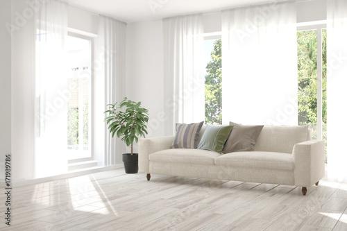 Fototapeta Idea of white room with sofa and summer landscape in window. Scandinavian interior design. 3D illustration obraz na płótnie
