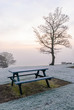 Bench in a park covered with frost