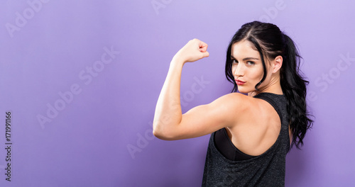 Fotografia Powerful young fit woman on a solid background