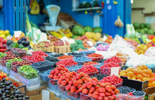 Assortment Of Fresh Berries And Fruits At Market